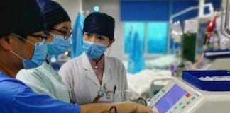 Doctors in the Department of Critical Care Medicine at Guangdong Medical University work in the intensive care unit where patients are being treated for COVID-19