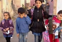 Young Naamat, a Syrian refugee in Jordan, helps take care of her brothers and sisters.