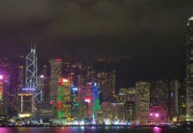 The skyline of Hong Kong harbour, seen at night.