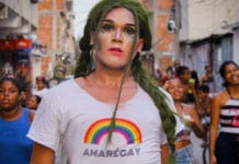 """Shout out in the Favela da Maré, in Rio de Janeiro, Brazil. The t-shirt reads 'Amarégay"""" -- a pun using the name of the favela, meaning both 'to love is gay' and 'Maré is gay'."""