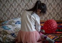 A five-year-old girl plays in her family's apartment in Kazakhstan, where UNICEF is working to eliminate domestic violence through home visits.