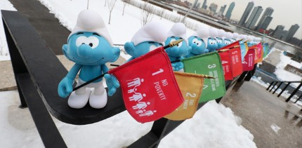 UNRIC Projects: Smurfs carrying SDG flags