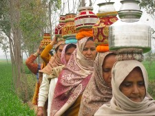 The Daughter Tree film image of Women carrying water
