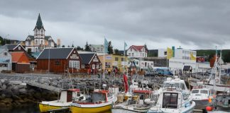Húsavík, Iceland has a population of 2,300 and is know for whale-watching.