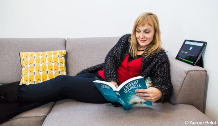 Person on couch reading to blind and visually impaired