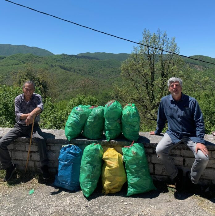 Dimitrios and friend Kostas with bags full of plastic waste