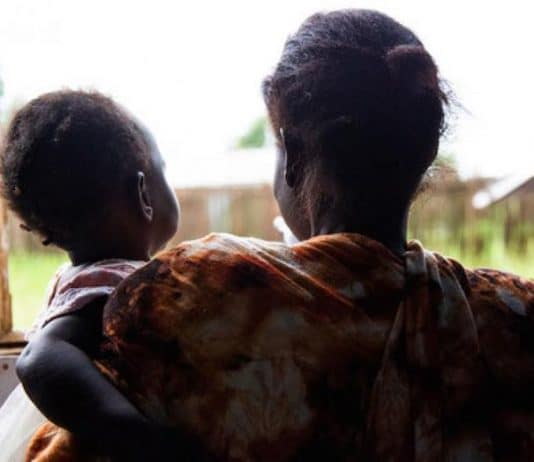 A victim of domestic violence with her child in South-Sudan.