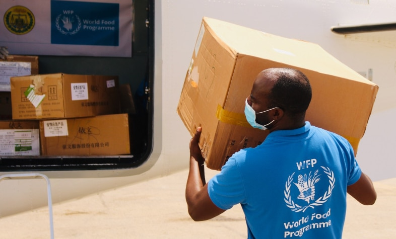 A WFP staffer loads protective equipment onto plane in Somalia-Photo-WFP-Jama Hassan