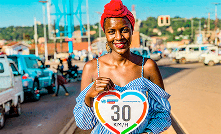 Woman holding speed limit sign