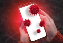 Person hands holding smartphone with dirty infectious bacteria and harmful germs on mobile smartphone display. Online hacker attack on confidential information or personal data.